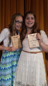 """Both girls were presented with two plaques declaring them """"Honorary Realityworks Engineers"""" at their middle school awards night."""